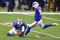 Buffalo Bills kicker Tyler Bass, right, kicks a field goal during the second half of an NFL football game against the New England Patriots Sunday, Nov. 1, 2020, in Orchard Park, N.Y. (AP Photo/Adrian Kraus)