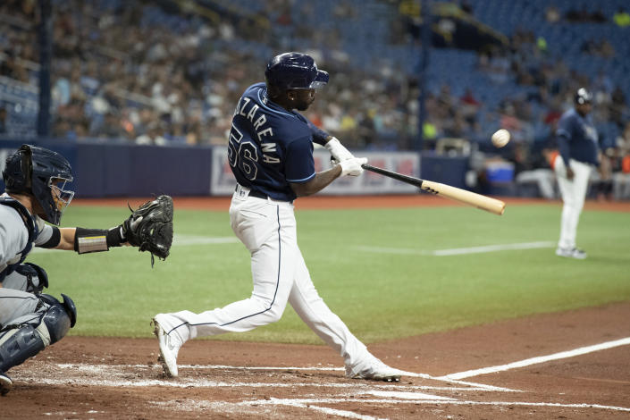 Tampa Bay Rays' Randy Arozarena hits a sacrifice fly against the Detroit Tigers during the first inning of a baseball game Thursday, Sept. 16, 2021, in St. Petersburg, Fla. (AP Photo/Scott Audette)