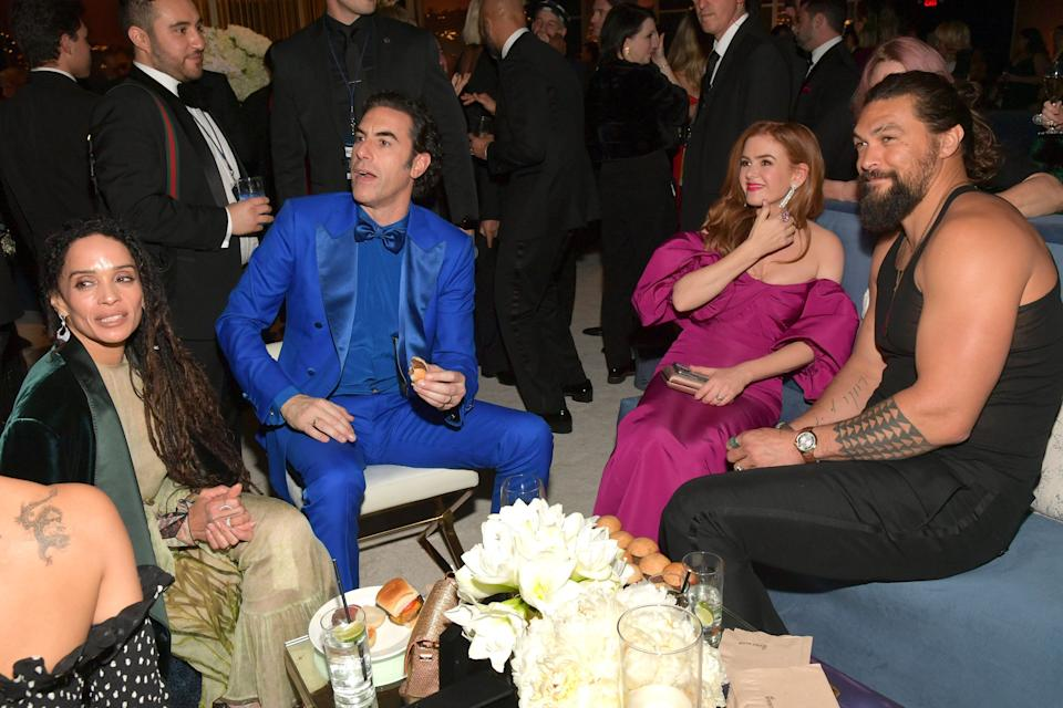 Jason Momoa (right, pictured with Lisa Bonet, Sacha Baron Cohen and Isla Fisher) later reappeared in the tank top at a Golden Globes after-party. (Photo: Lester Cohen via Getty Images)