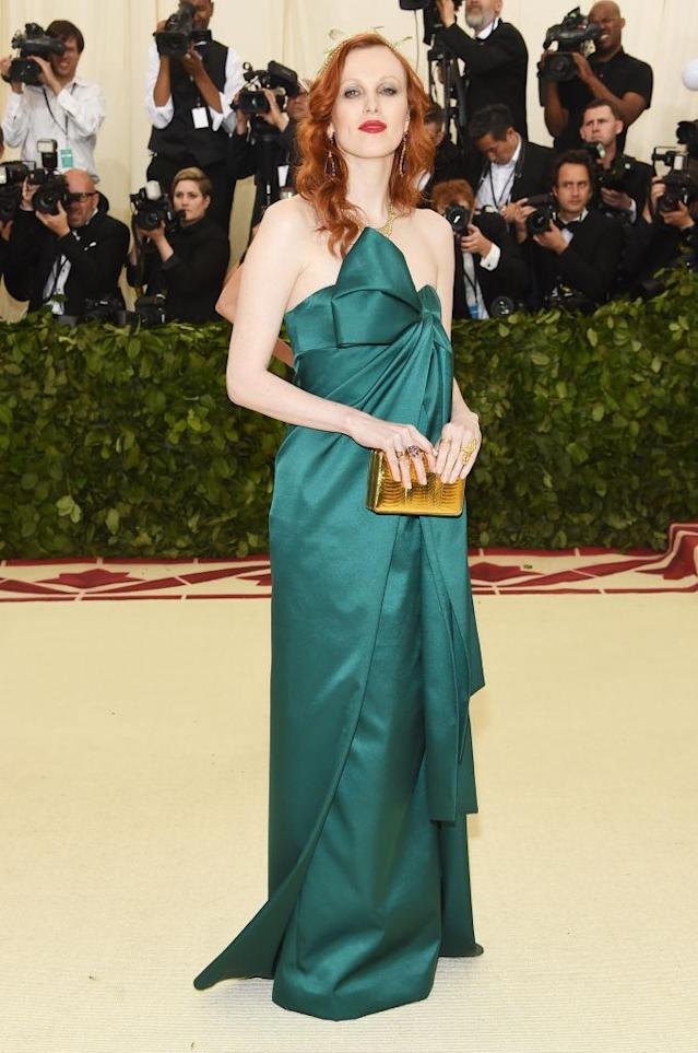 <p>Karen Elson attends the Heavenly Bodies: Fashion & The Catholic Imagination Costume Institute Gala at The Metropolitan Museum of Art on May 7, 2018 in New York City. (Photo: Getty Images) </p>