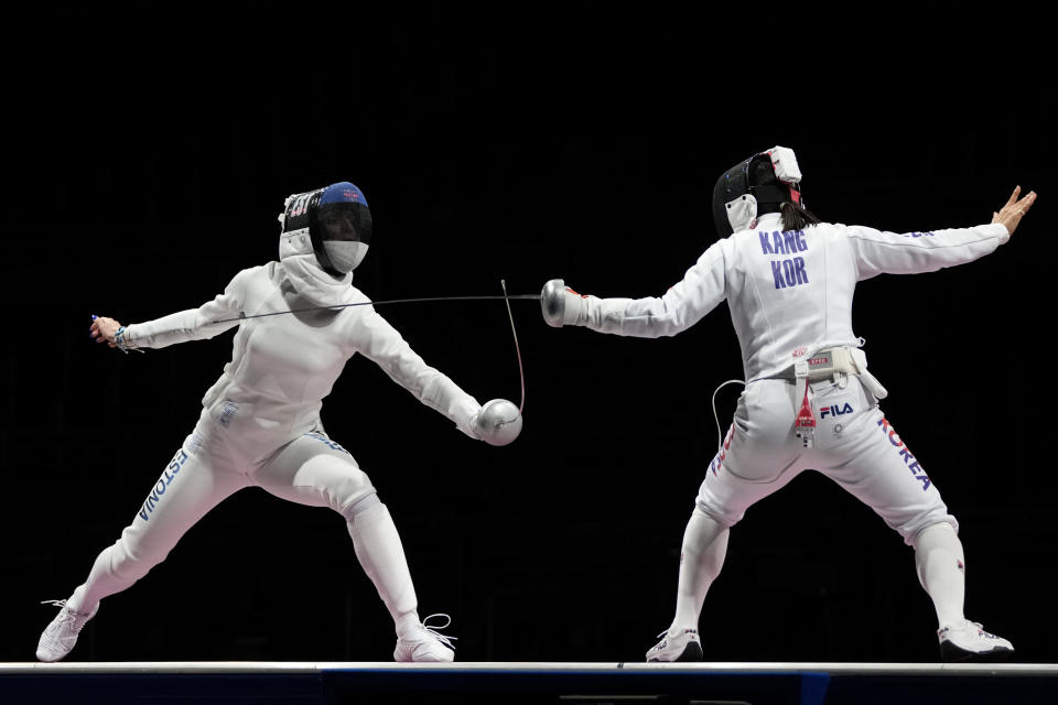 Katrina Lehis of Estonia, left, and Kang Young Mi of South Korea compete in the women's individual Epee team final competition at the 2020 Summer Olympics, Tuesday, July 27, 2021, in Chiba, Japan. (AP Photo/Hassan Ammar)