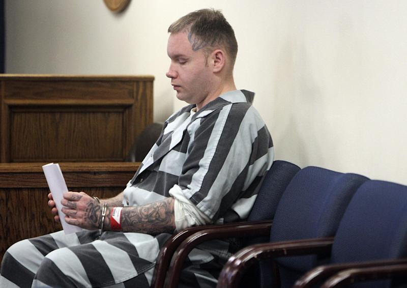 CORRECTS TO JUDGE HAMILTON, NOT COLLINS IN SECOND SENTENCE - Don Willburn Collins waits to be placed into the custody of the Montgomery County Sheriff's Office following a hearing at the 359th Judicial District Court with Judge Kathleen Hamilton on Thursday, March 6, 2014, in Conroe, Texas. Collins, now 28, accused of dousing Robert Middleton with gasoline and setting him on fire in 1998 when he was a teenager, can be tried as an adult for murder after the victim died from his burns nearly 13 years later, Judge Hamilton ruled Thursday. (AP Photo/ The Courier, Jason Fochtman) MANDATORY CREDIT