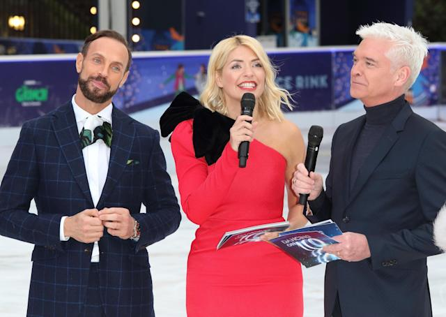 Jason Gardiner, Holly Willoughby and Phillip Schofield at the Dancing On Ice Launch Showcase at the Natural History Museum Ice Rink, Kensington,. (Photo by Keith Mayhew/SOPA Images/LightRocket via Getty Images)