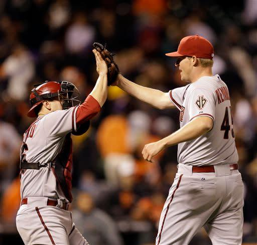 Arizona Diamondbacks' Matt Reynolds, right, celebrates with catcher Miguel Montero after the 6-4 defeat of the San Francisco Giants in the eleventh inning of a baseball game Tuesday, April 23, 2013, in San Francisco. (AP Photo/Ben Margot)