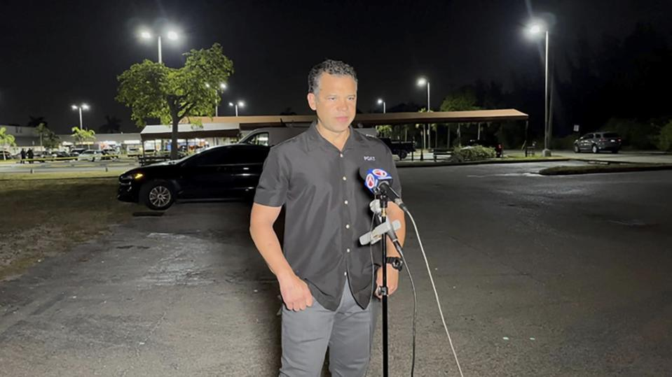 """Miami-Dade Police Director Alfredo """"Freddy"""" Ramirez speaks at the scene of a shooting outside a banquet hall near Hialeah, Fla., Sunday, May 30, 2021. Two people died and an estimated 20 to 25 people were injured in a shooting outside a banquet hall in South Florida, police said. The gunfire erupted early Sunday at the El Mula Banquet Hall in northwest Miami-Dade County, near Hialeah, police told news outlets. (Devoun Cetourte/Miami Herald via AP)"""
