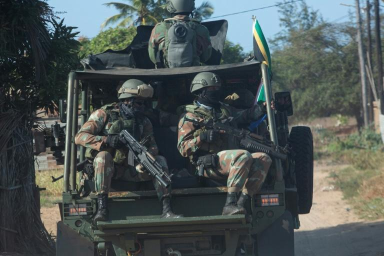 A convoy of South Africa National Defence Forces patrols the Maringanha district in Pemba on Thursday