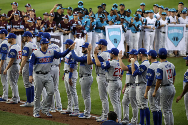 Chicago Cubs' Anthony Rizzo is introduced before the Little League Classic baseball game against the Chicago Cubs at Bowman Stadium in Williamsport, Pa., on Sunday, Aug. 18, 2019. (AP Photo/Gene J. Puskar)
