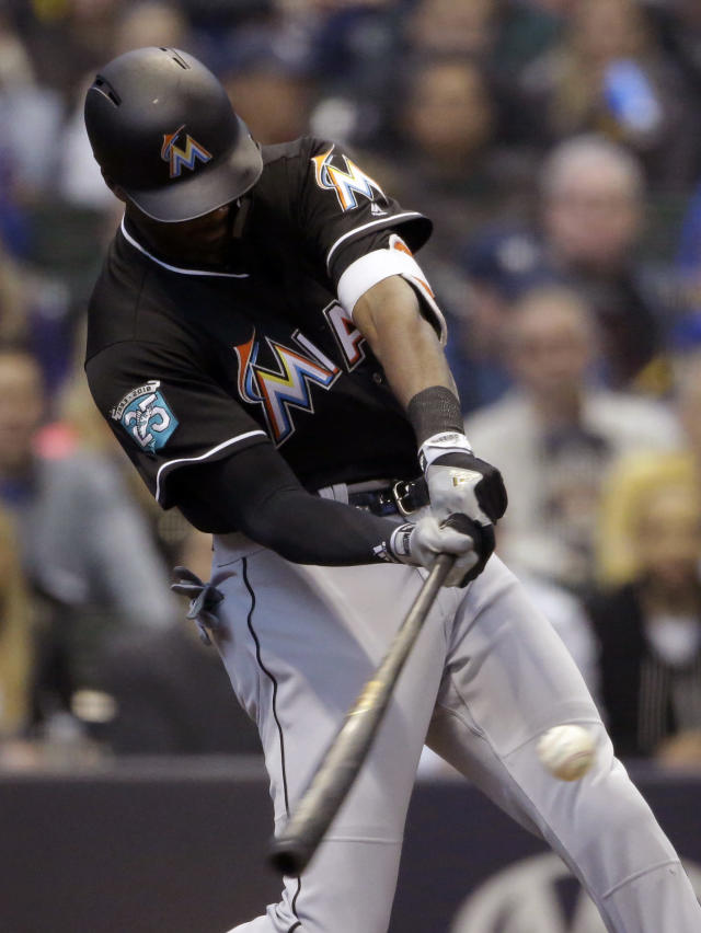 Miami Marlins' Lewis Brinson hits a three-run home run during the second inning of a baseball game against the Milwaukee Brewers, Saturday, April 21, 2018, in Milwaukee. (AP Photo/Aaron Gash)
