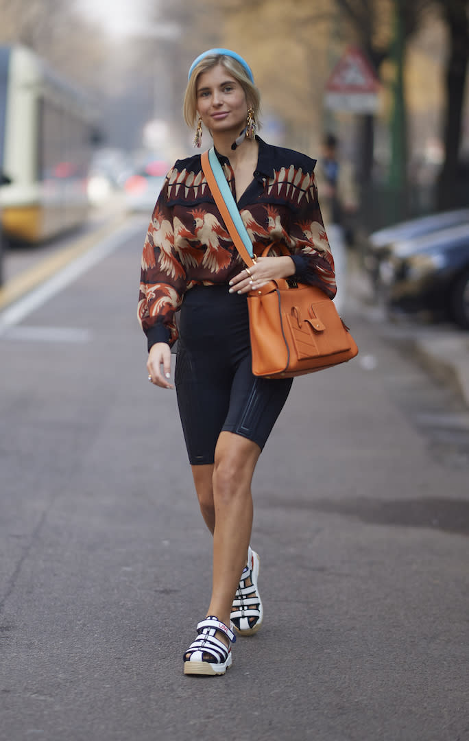<p>Xenia Adonts photographed on day two of Milan Fashion Week tackling three major trends in one fashionable swoop. Cycling shorts? Tick. Headband? Tick. Chunky sandals? Nailed it. <em>[Photo: Getty]</em> </p>