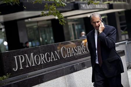 Man walks past JP Morgan Chase's international headquarters on Park Avenue in New York