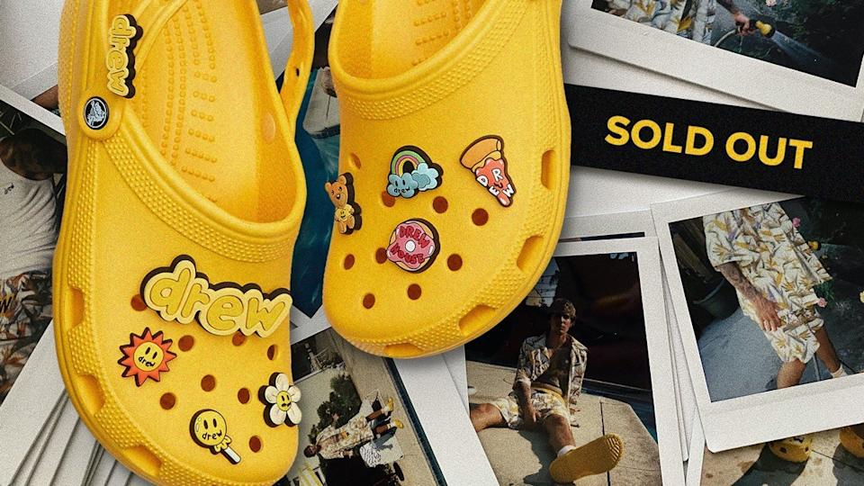 "embellished yellow crocs next to a sign reading ""sold out"""