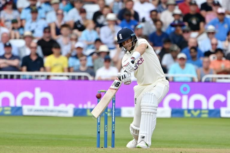 On the attack - England captain Joe Root drives on the first day of the first Test against India at Trent Bridge on Wednesday