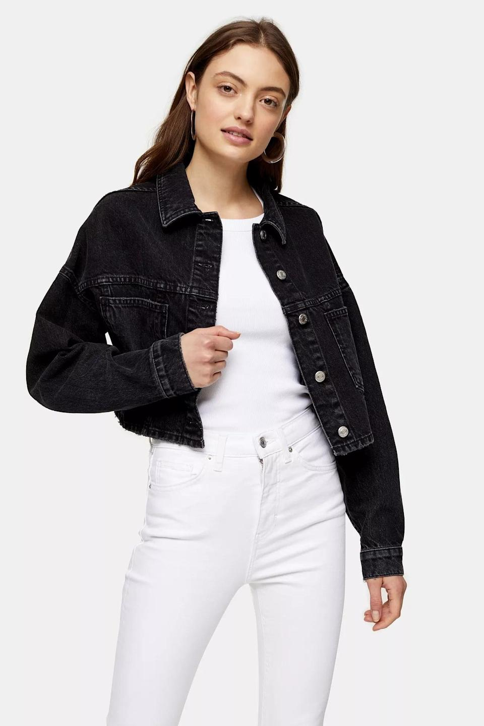 "<p>Chilly summer nights require this lightweight <a href=""https://www.popsugar.com/buy/Topshop-Washed-Black-Cropped-Denim-Jacket-582003?p_name=Topshop%20Washed%20Black%20Cropped%20Denim%20Jacket&retailer=us.topshop.com&pid=582003&price=75&evar1=fab%3Aus&evar9=35329485&evar98=https%3A%2F%2Fwww.popsugar.com%2Ffashion%2Fphoto-gallery%2F35329485%2Fimage%2F47550209%2FTopshop-Washed-Black-Cropped-Denim-Jacket&list1=shopping%2Cdenim%2Csummer%20fashion%2Cfashion%20shopping&prop13=mobile&pdata=1"" class=""link rapid-noclick-resp"" rel=""nofollow noopener"" target=""_blank"" data-ylk=""slk:Topshop Washed Black Cropped Denim Jacket"">Topshop Washed Black Cropped Denim Jacket</a> ($75).</p>"