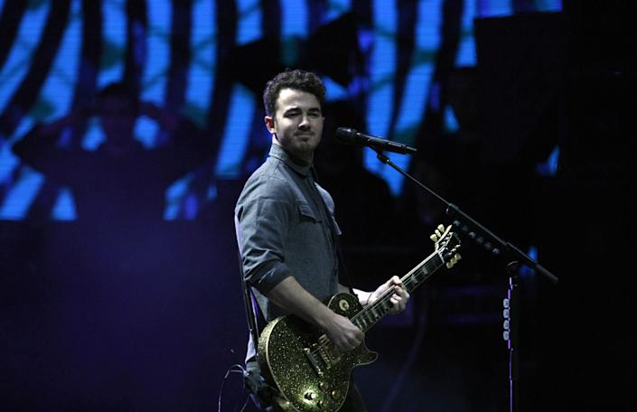 Kevin Jonas, member of the band Jonas Brothers, performs at the Vina del Mar International Song Festival in Vina del Mar, Chile, Tuesday, Feb. 26, 2013. Believed to be one of the largest musical events in Latin America, the annual 5-day festival was inaugurated in 1960. (AP Photo/Luis Hidalgo)