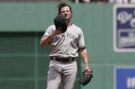 New York Yankees' Gerrit Cole removes his cap while standing on the mound after giving up a home run in the first inning of a baseball game against the Boston Red Sox, Sunday, June 27, 2021, in Boston. (AP Photo/Steven Senne)