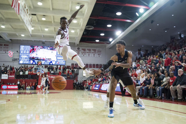 Butler forward Jordan Tucker (1) passes the ball past St. John's guard Rasheem Dunn (3) during the second half of an NCAA college basketball game, Tuesday, Dec. 31, 2019, in New York. (AP Photo/Julius Constantine Motal)