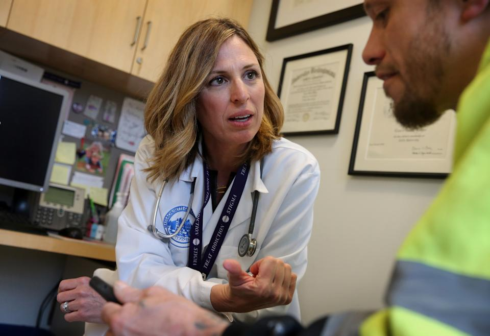 BOSTON, MA - APRIL 27: Dr. Laura Kehoe talks to a patient during his appointment as Mass. General Hospital in Boston on April 27, 2018. The patient takes Suboxone, a medicine that contains buprenorphine and naloxone, to treat his substance use disorder. He said he had been addicted to Opioids for 10 years but has been drug free since he started taking Suboxone nearly 2 years ago.  (Photo by Craig F. Walker/The Boston Globe via Getty Images)