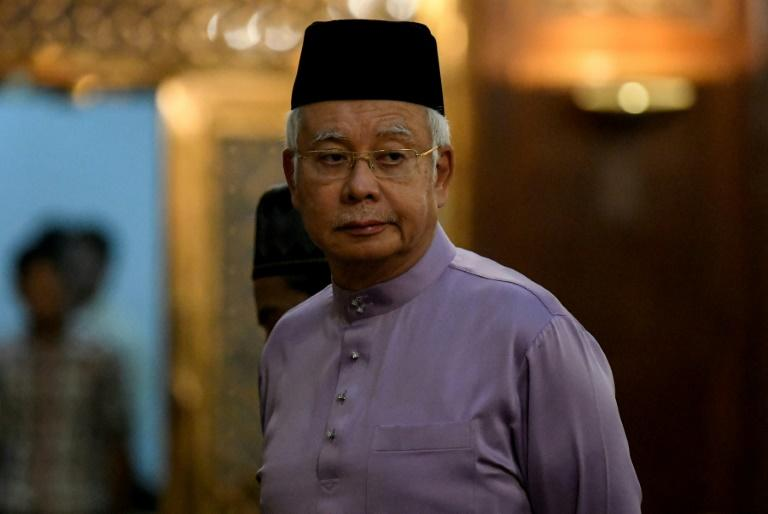 Malaysia's former prime minister Najib Razak is barred from leaving Malaysia and police have seized large amounts of cash, jewels and luxury items from his home and other sites