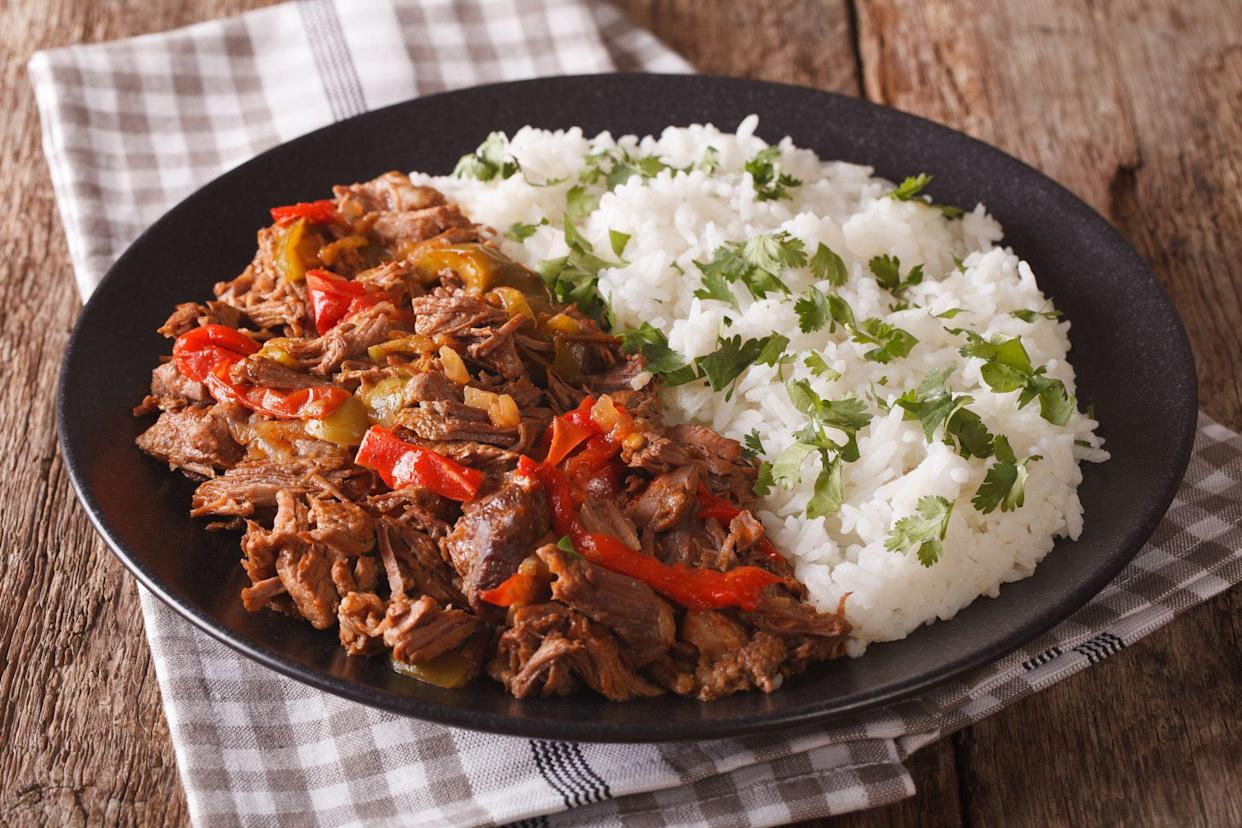 ropa vieja and white rice on plate