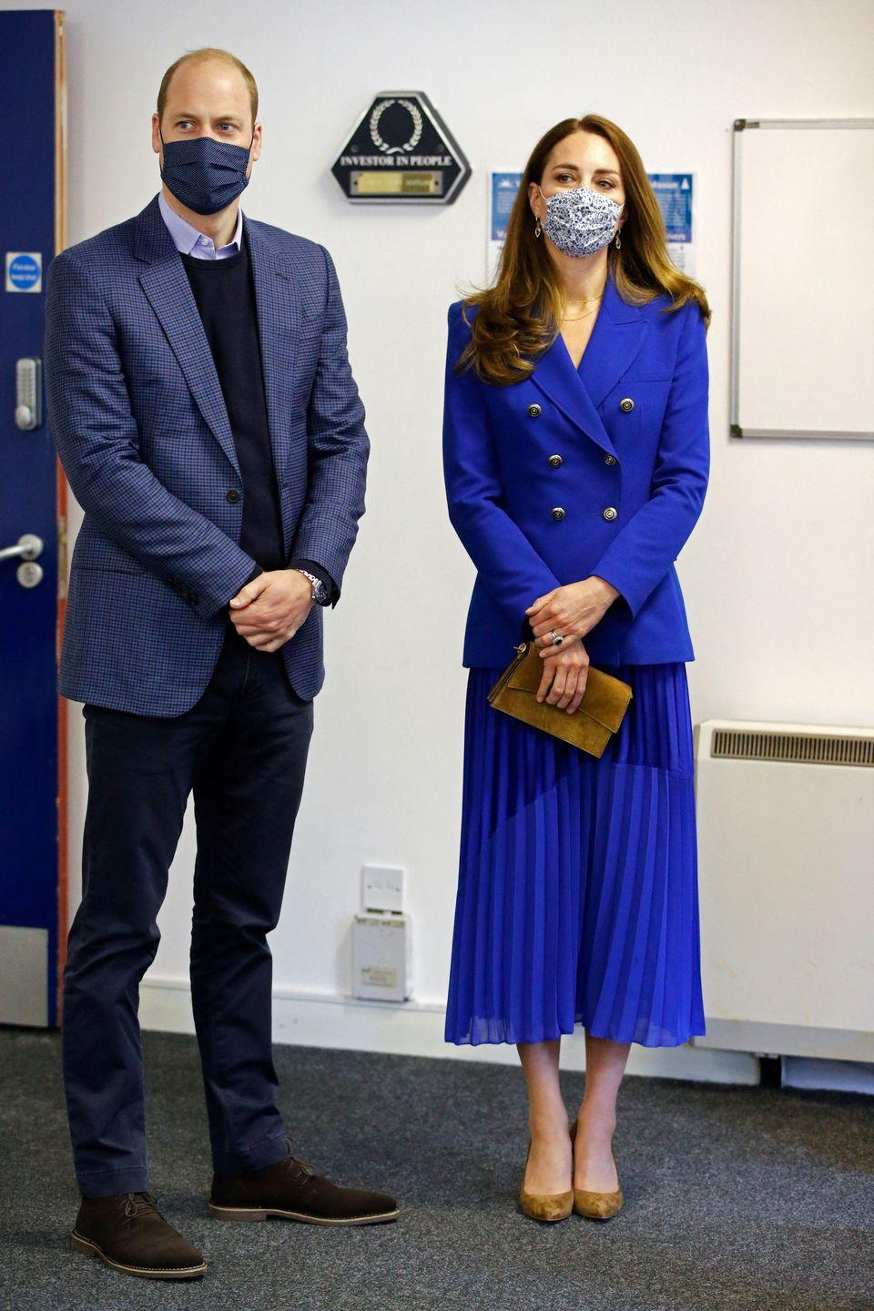 """<p>During Kate and Prince William's tour of Scotland, the Duchess wore an all-cobalt outfit. She paired a double-breasted Zara blazer with a <a href=""""https://go.redirectingat.com?id=74968X1596630&url=https%3A%2F%2Fhopefashion.co.uk%2Fcollections%2Fthe-collection%2Fproducts%2Fthe-contrast-hem-pleated-skirt-cobalt&sref=https%3A%2F%2Fwww.townandcountrymag.com%2Fstyle%2Ffashion-trends%2Fnews%2Fg1633%2Fkate-middleton-fashion%2F"""" rel=""""nofollow noopener"""" target=""""_blank"""" data-ylk=""""slk:midi skirt from British brand, Hope"""" class=""""link rapid-noclick-resp"""">midi skirt from British brand, Hope</a>, and carried <a href=""""https://us.metierlondon.com/products/roma-mini-clutch-bag-suede-marrakech"""" rel=""""nofollow noopener"""" target=""""_blank"""" data-ylk=""""slk:a Métier clutch"""" class=""""link rapid-noclick-resp"""">a Métier clutch</a>. </p>"""