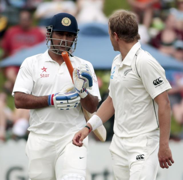 India's MS Dhoni (R) and New Zealand's Neil Wagner exchange words during the first innings on day two of the second international test cricket match at the Basin Reserve in Wellington, February 15, 2014. REUTERS/Anthony Phelps (NEW ZEALAND - Tags: SPORT CRICKET)