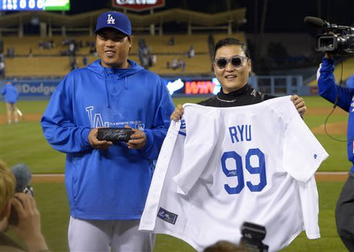 Los Angeles Dodgers starting pitcher Hyun-Jin Ryu, left, of Korea, and Korean pop artist PSY pose together after the Dodgers defeated the Colorado Rockies 6-2 in their baseball game, Tuesday, April 30, 2013, in Los Angeles. (AP Photo/Mark J. Terrill)