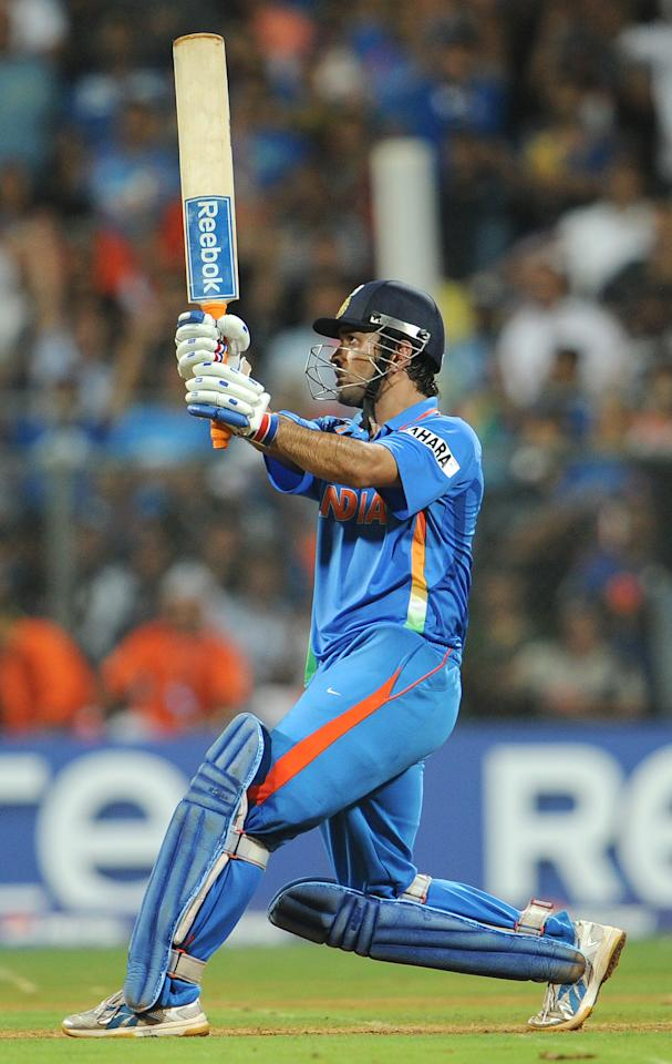 Indian captain Mahendra Singh Dhoni hits a six to give India victory over Sri Lanka in the ICC Cricket World Cup 2011 final played at The Wankhede Stadium in Mumbai on April 2, 2011.  India beat Sri Lanka by six wickets. AFP PHOTO/William WEST (Photo credit should read WILLIAM WEST/AFP/Getty Images)