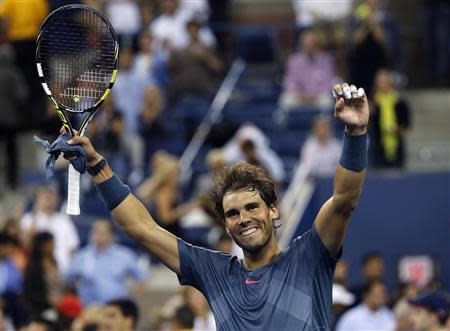 Rafael Nadal of Spain celebrates defeating compatriot Tommy Robredo during their men's quarter-final match at the U.S. Open tennis championships in New York September 4, 2013. REUTERS/Ray Stubblebine