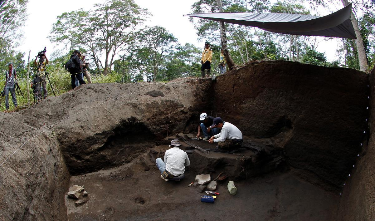 "In this June 20, 2011 photo, a team from the Institute for Archaeology conduct excavations in the area of coffee plantations in the hamlet of Tambora on the foot of Mount Tambora, Bima, West Nusa Tenggara, Indonesia. The April 1815 eruption of Tambora left a crater 11 kilometers (7 miles) wide and 1 kilometer (half a mile) deep, spewing an estimated 400 million tons of sulfuric gases into the atmosphere and leading to ""the year without summer"" in the U.S. and Europe. (AP Photo/KOMPAS Images, Fikria Hidayat) EDITORIAL USE ONLY"