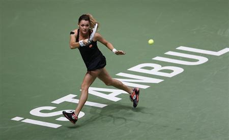 Agnieszka Radwanska of Poland hits a return to Angelique Kerber of Germany during their WTA tennis championships match at Sinan Erdem Dome in Istanbul, October 24, 2013. REUTERS/Murad Sezer
