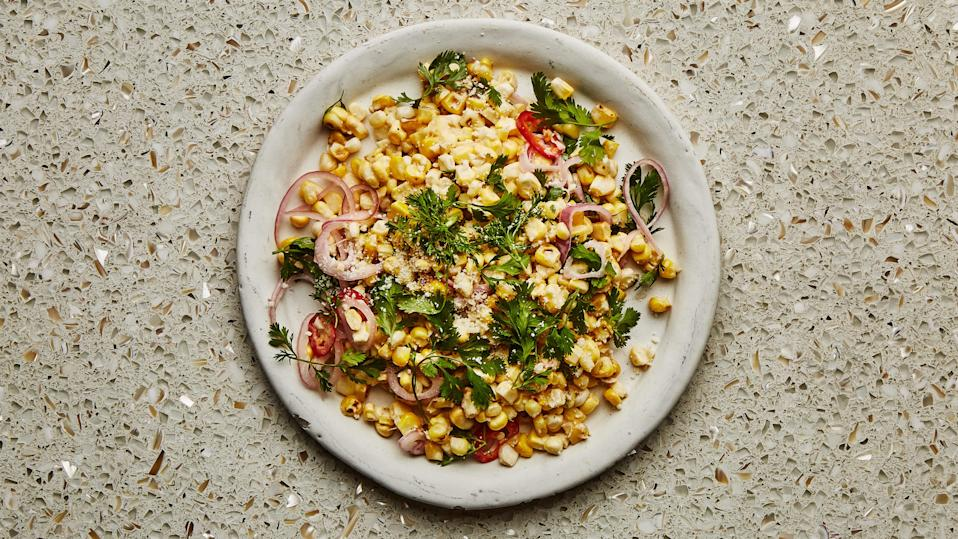 "All the flavors of a Mexican grilled corn on the cob, now in a convenient, tossed-together form. <a href=""https://www.bonappetit.com/recipe/charred-and-raw-corn-with-chile-and-cheese?mbid=synd_yahoo_rss"" rel=""nofollow noopener"" target=""_blank"" data-ylk=""slk:See recipe."" class=""link rapid-noclick-resp"">See recipe.</a>"