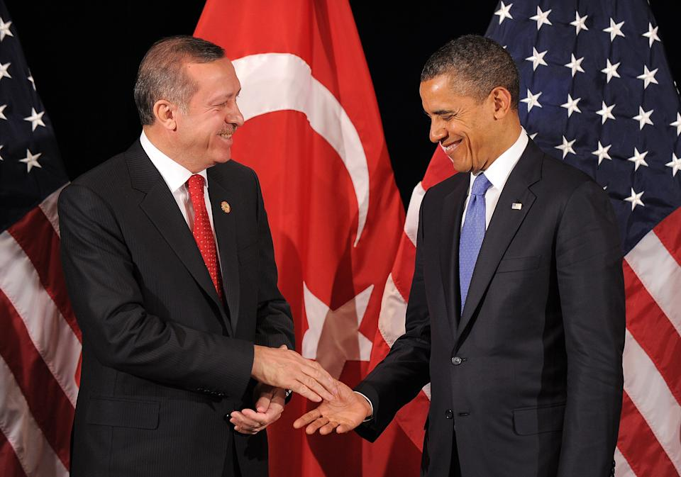 U.S. President Barack Obama (R) shakes hands with Turkish Prime Minister Recep Tayyip Erdogan after their bilateral meeting in Seoul on March 25, 2012 on the eve of the 2012 Seoul Nuclear Security Summit.