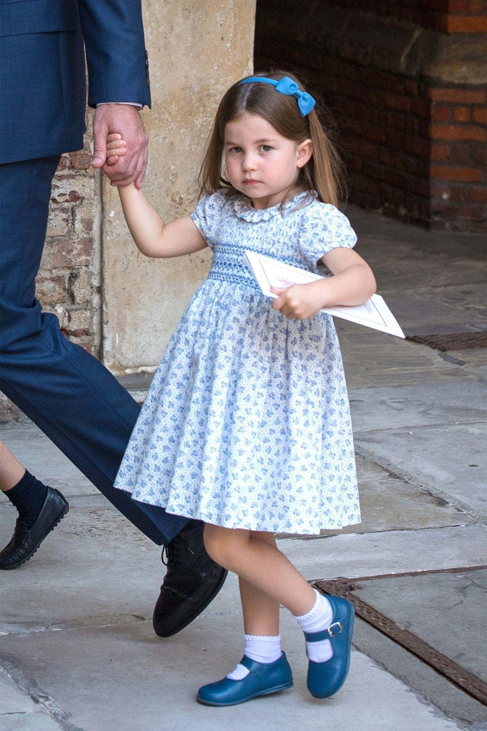 <p>Princess Charlotte gives a serious look at photographers capturing the family exiting Prince Louis's christening. </p>
