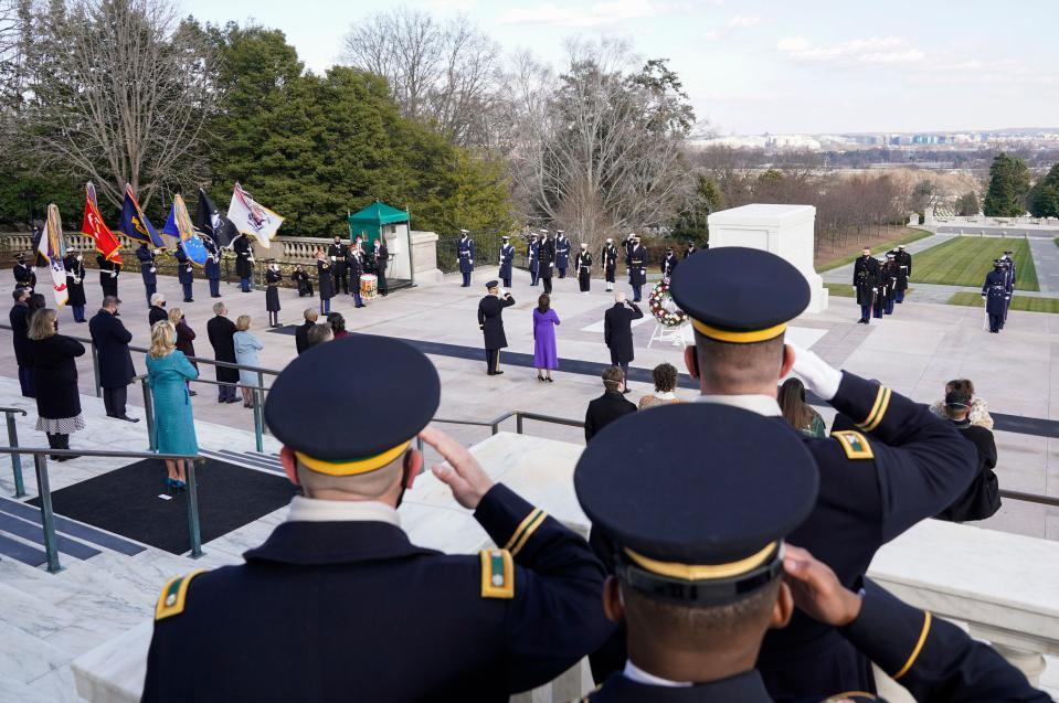 US President Joe Biden, Vice President Kamala Harris and Major General Omar J. Jones salute at the Tomb of the Unknown Soldier at Arlington National Cemetery, in Arlington, Virginia, January 20, 2021. (Photo by JOSHUA ROBERTS / POOL / AFP) (Photo by JOSHUA ROBERTS/POOL/AFP via Getty Images)
