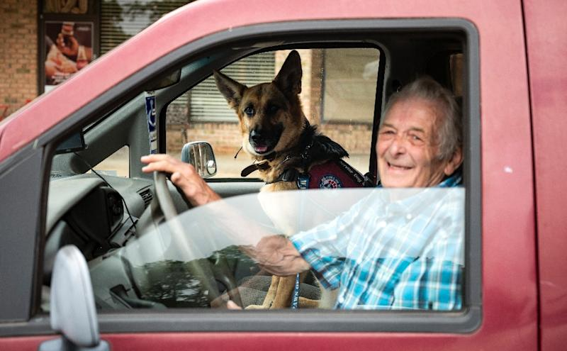 US military veteran Michael Kidd and his companion dog Millie leave after a training session at the Paws of War office in Nesconset, New York -- Millie helps Kidd navigate the difficulties of post-traumatic stress disorder (AFP Photo/Johannes EISELE)
