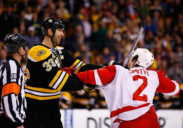 BOSTON, MA - APRIL 20: Zdeno Chara #33 of the Boston Bruins has a scuffle with Brendan Smith #2 of the Detroit Red Wings in the first period during the game at TD Garden on April 20, 2014 in Boston, Massachusetts. (Photo by Jared Wickerham/Getty Images)