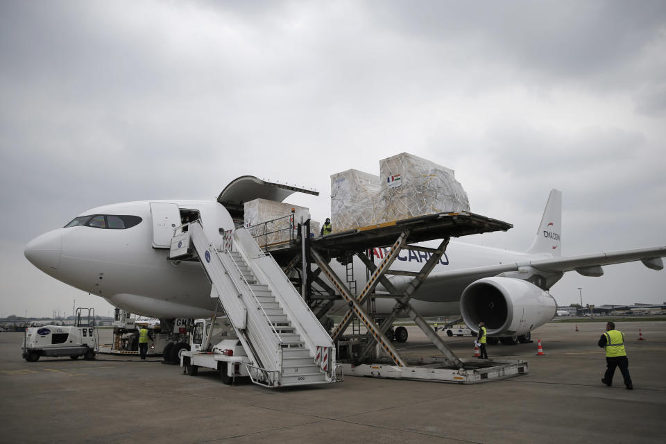 Medical supplies and relied materials are loaded into a cargo plane to India at Roissy airport, north of Paris, Saturday, May 1, 2021. France sends oxygen respiratory equipment and generators to India to help the country deal with the serious COVID-19 crisis. (AP Photo/Lewis Joly, Pool)