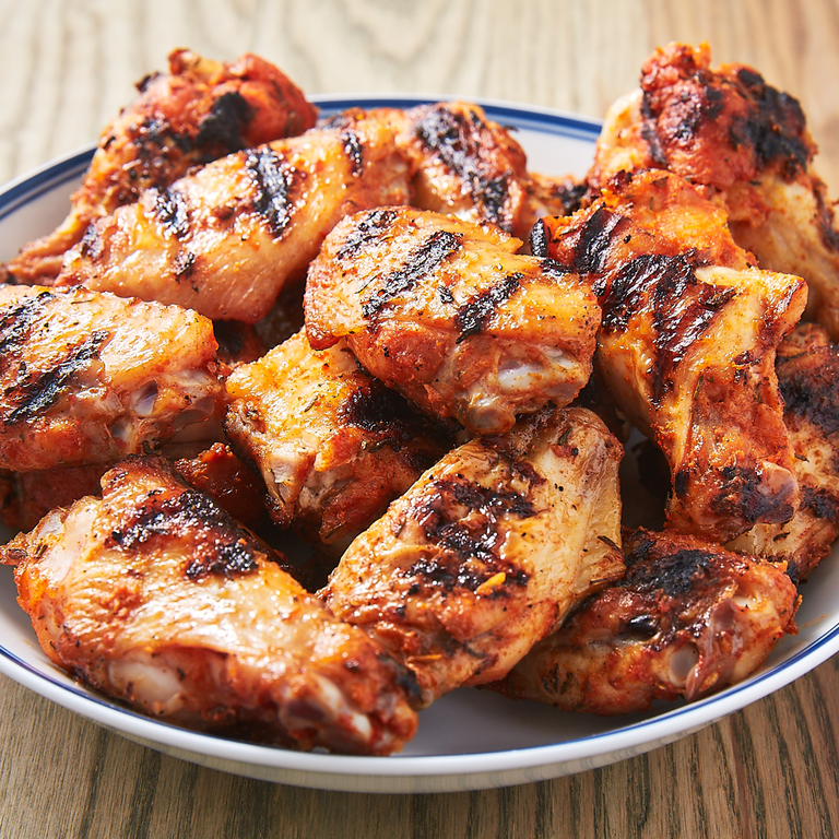 """<p>We've <a href=""""https://www.delish.com/uk/cooking/recipes/a30975501/fried-chicken-wings-recipe/"""" rel=""""nofollow noopener"""" target=""""_blank"""" data-ylk=""""slk:fried our chicken wings"""" class=""""link rapid-noclick-resp"""">fried our chicken wings</a> and we've <a href=""""https://www.delish.com/uk/cooking/recipes/a30638308/easy-oven-baked-chicken-wings/"""" rel=""""nofollow noopener"""" target=""""_blank"""" data-ylk=""""slk:baked our chicken wings"""" class=""""link rapid-noclick-resp"""">baked our chicken wings</a>, but there's a special place in our heart for these super easy grilled chicken wings. They cook up fast (like, 15 to 20 minutes fast), they're coated in a seriously delicious spice rub, and they've got a zingy dipping sauce you'll want to eat with everything.</p><p>Get the <a href=""""https://www.delish.com/uk/cooking/a35126959/grilled-chicken-wings-recipe/"""" rel=""""nofollow noopener"""" target=""""_blank"""" data-ylk=""""slk:Grilled Chicken Wings"""" class=""""link rapid-noclick-resp"""">Grilled Chicken Wings</a> recipe.</p>"""