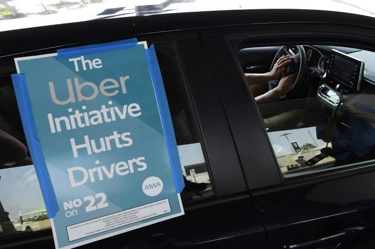 California voters approved a referendum allowing ride-hailing giants to keep their model of using independent contractors, effectively overturning a state law requiring drivers to be classified as employees