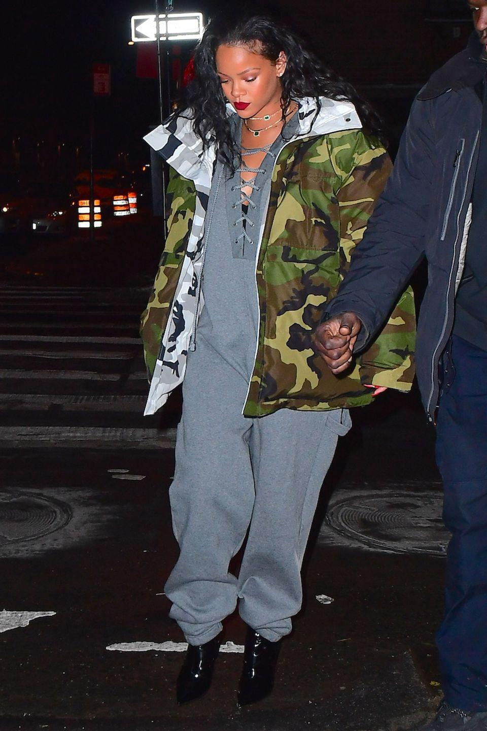 <p>In a grey lace-up Fenty x Puma jumpsuit, Vetements x Canada Goose camo parka and patent leather boots while out in NYC.</p>