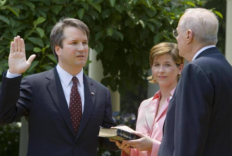 Brett Kavanaugh is sworn in as a US Court of Appeals Judge for the District of Columbia by US Supreme Court Justice Anthony Kennedy (PAUL J. RICHARDS/AFP/Getty Images)