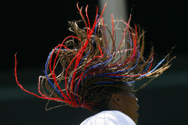 Venus Williams of the U.S. takes part in a training session at the All England Lawn Tennis Club before the start of the London 2012 Olympic Games in London July 26, 2012. REUTERS/Stefan Wermuth (BRITAIN - Tags: SPORT OLYMPICS TENNIS TPX IMAGES OF THE DAY)