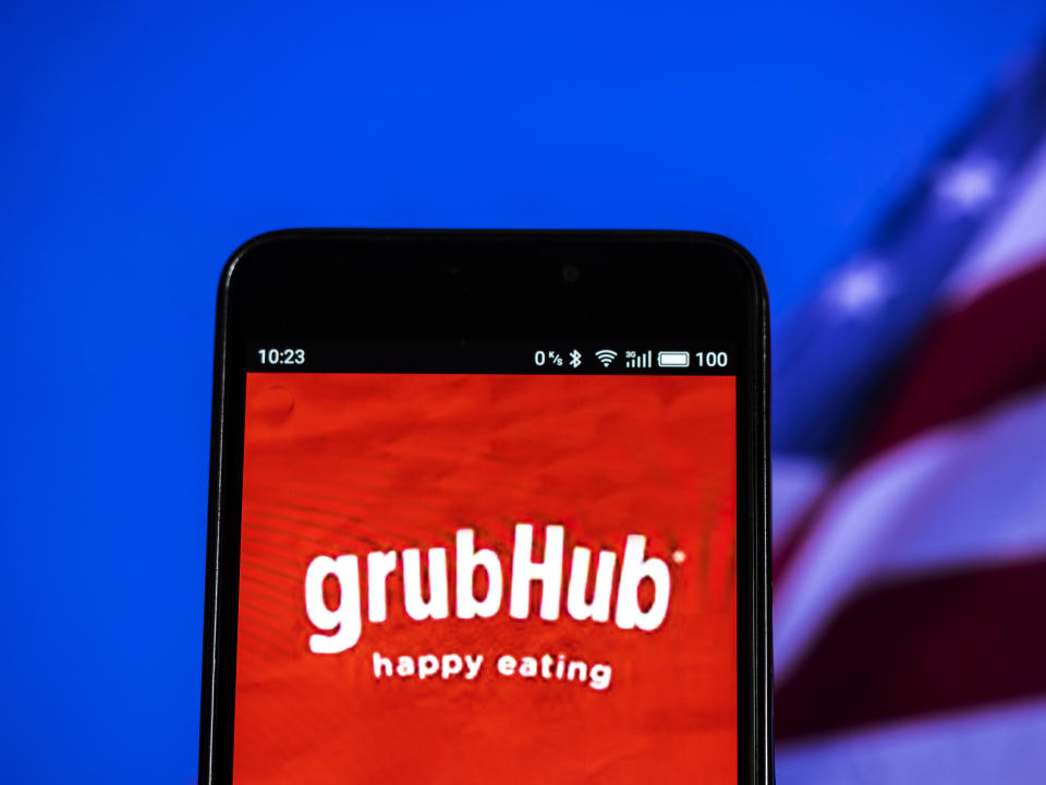 KIEV, UKRAINE - 2018/09/16:  In this photo illustration, the GrubHub logo seen displayed on a smartphone. Grubhub Inc. is an on line and mobile food-ordering company that connects diners with local restaurants. Based in Chicago, the company has more than 14 million active diners, and approximately 80,000 restaurant partners in over 1,600 cities across the United States and the United Kingdom. (Photo Illustration by Igor Golovniov/SOPA Images/LightRocket via Getty Images)