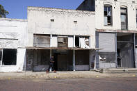 Vacant, unkept and weather worn store fronts line a street in downtown Itta Bena, Miss., Thursday, Oct. 22, 2020. Area residents believe the high price of electricity provided by the city as one of the reasons for store closures. (AP Photo/Rogelio V. Solis)