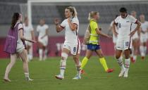 United States' players leave the field after losing 0-3 against Sweden during a women's soccer match at the 2020 Summer Olympics, Wednesday, July 21, 2021, in Tokyo. (AP Photo/Ricardo Mazalan)