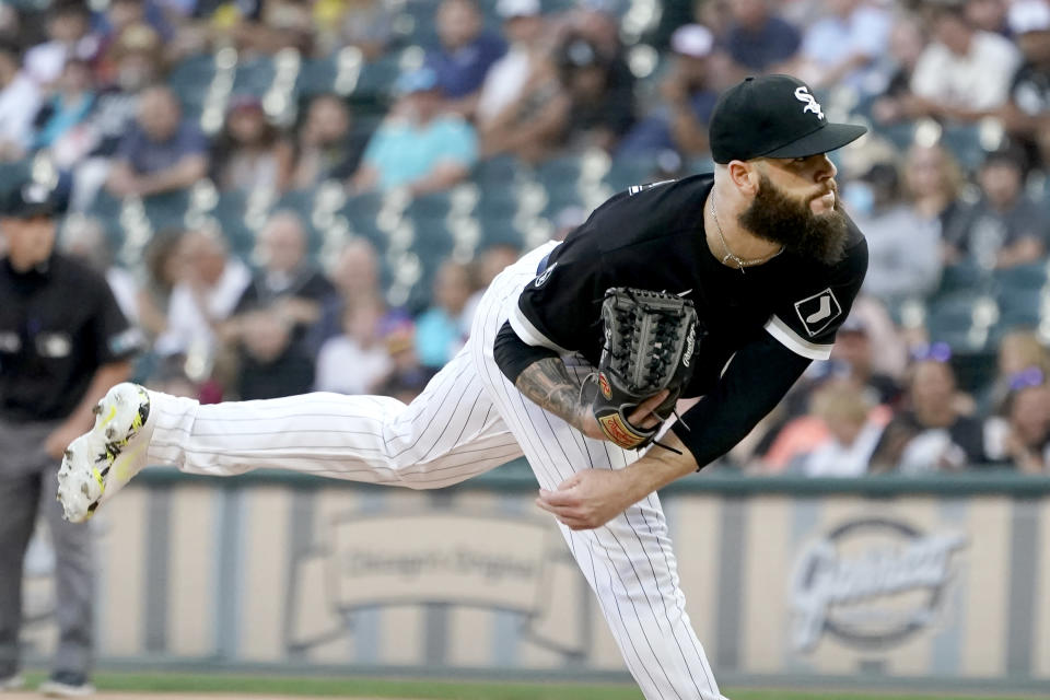 Chicago White Sox starting pitcher Dallas Keuchel follows through during the first inning of a baseball game against the Kansas City Royals Thursday, Aug. 5, 2021, in Chicago. (AP Photo/Charles Rex Arbogast)