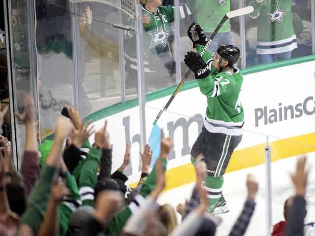Dallas Stars center Devin Shore celebrates his second goal against the San Jose Sharks, during the third period of an NHL hockey game Thursday, Nov. 8, 2018, in Dallas. Dallas won 4-3. (AP Photo/Jeffrey McWhorter)