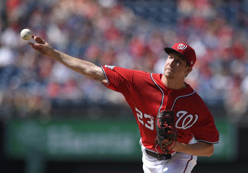 Washington Nationals starting pitcher Erick Fedde delivers during the first inning of a baseball game against the Philadelphia Phillies, Saturday, June 23, 2018, in Washington. (AP Photo/Nick Wass)