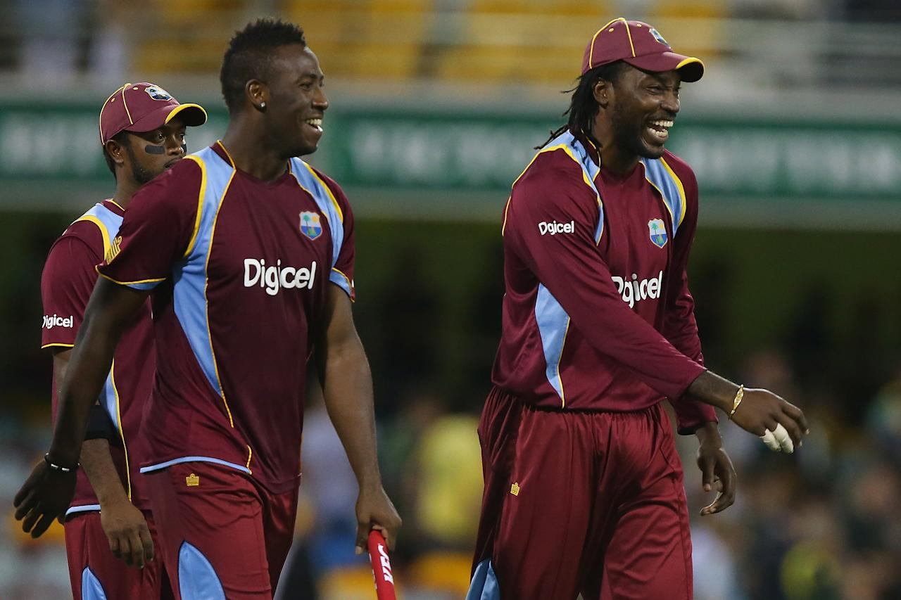 BRISBANE, AUSTRALIA - FEBRUARY 13:  Andre Russell and Chris Gayle of the West Indies celebrate winning the International Twenty20 match between Australia and the West Indies at The Gabba on February 13, 2013 in Brisbane, Australia.  (Photo by Chris Hyde/Getty Images)