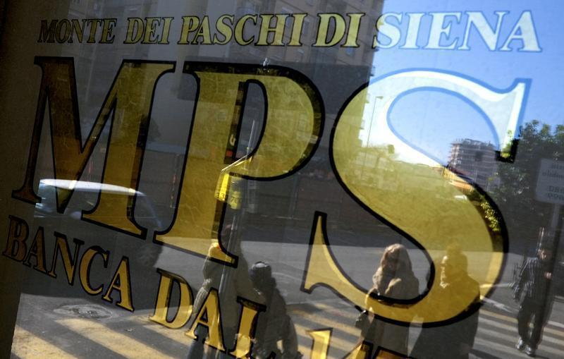 People are reflected in the window of a Monte Dei Paschi Di Siena bank in Rome